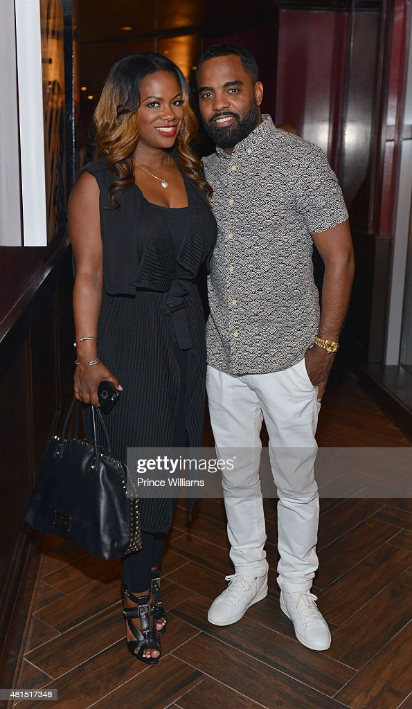 Kandi Burruss and Todd Tucker attend 'Tiny' Tameka Harris Celebrity Birthday Affair at Scales 925 Restaurant on July 14, 2015 in Atlanta, Georgia.