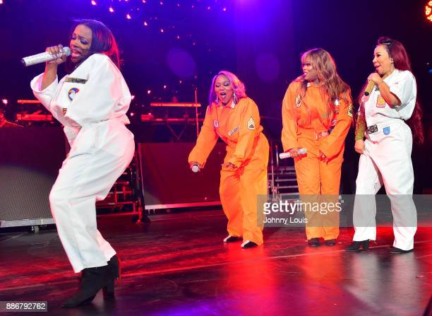Kandi Burruss LaTocha Scott Tamika Scott and Tameka Cottle and of Xscape perform during The Great Xscape tour at American Airlines Arena on December...