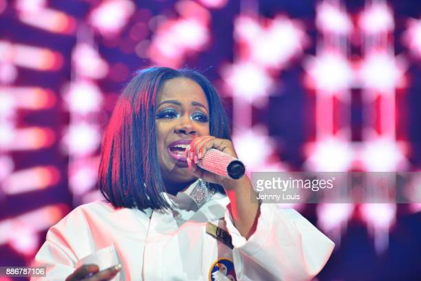 Kandi Burruss of Xscape perform during The Great Xscape tour at American Airlines Arena on December 5 2017 in Miami Florida