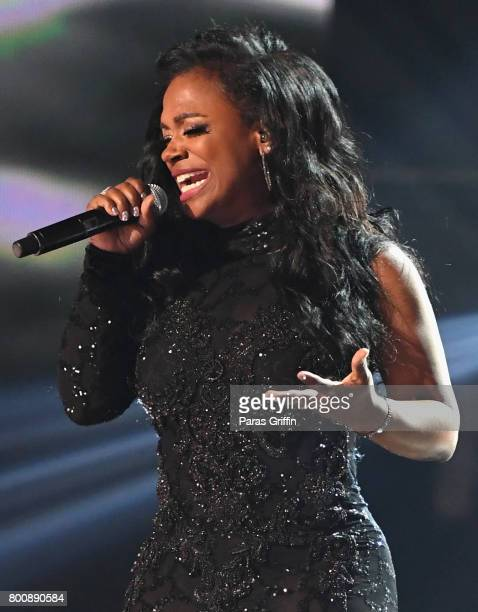 Kandi Burruss of Xscape performs onstage at 2017 BET Awards at Microsoft Theater on June 25 2017 in Los Angeles California