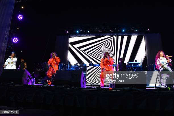 Kandi Burruss Tamika Scott LaTocha Scott and Tameka Cottle of Xscape perform during The Great Xscape tour at American Airlines Arena on December 5...