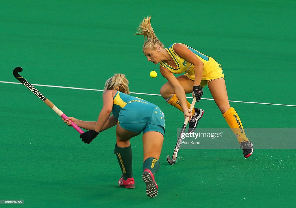 Kandice Oliveri of the Hockeyroos jumps clear from a pass by Ashlea Fey of the Jillaroos during the womens Australia v Australia under 21 game on day one of the 2012 International Super Series at Perth Hockey Stadium on November 22, 2012 in Perth, Australia.
