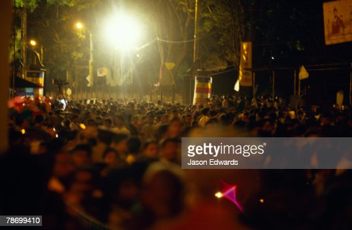 A massive crowd fill the streets to watch the Esala Perahera parade.