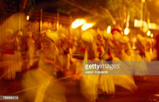 Kandian dancers parade through the streets at the Esala Perahera.