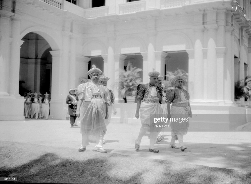 Kandyan chiefs in their finest regalia, arriving to be presented to the Duke of Gloucester at the King's Pavilion, Kandy, Ceylon (Sri Lanka).