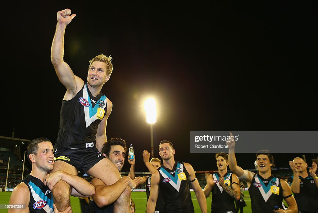 <a gi-track='captionPersonalityLinkClicked' href=/galleries/search?phrase=Kane+Cornes&family=editorial&specificpeople=176523 ng-click='$event.stopPropagation()'>Kane Cornes</a> of the Power is carried off by his team mates after playing his 250th match after the round five AFL match between Port Adelaide Power and the West Coast Eagles at AAMI Stadium on April 27, 2013 in Adelaide, Australia.