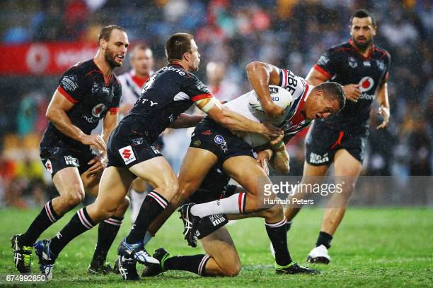 Kane Evans of the Roosters charges forward during the round nine NRL match between the New Zealand Warriors and the Sydney Roosters at Mt Smart...