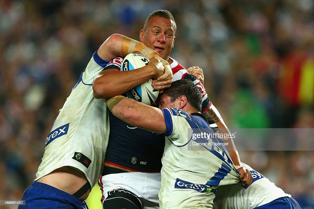 Kane Evans of the Roosters is tackled during the First NRL Semi Final match between the Sydney Roosters and the Canterbury Bulldogs at Allianz Stadium on September 18, 2015 in Sydney, Australia.