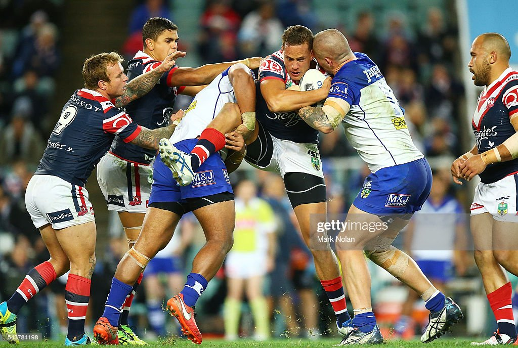 Kane Evans of the Roosters is tackled during the round 17 NRL match between the Sydney Roosters and the Canterbury Bulldogs at Allianz Stadium on June 30, 2016 in Sydney, Australia.