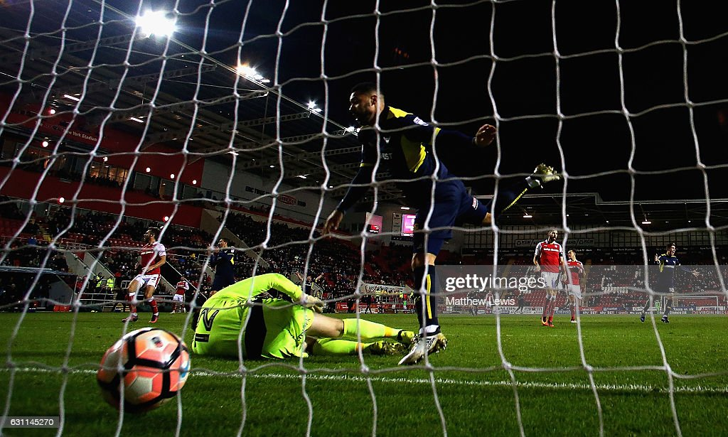 Kane Hemmings of Oxford United beats Lewis Price of Rotherham United to score his teams third goal during The Emirates FA Cup Third Round match between Rotherham United and Oxford United at The New York Stadium on January 7, 2017 in Rotherham, England.