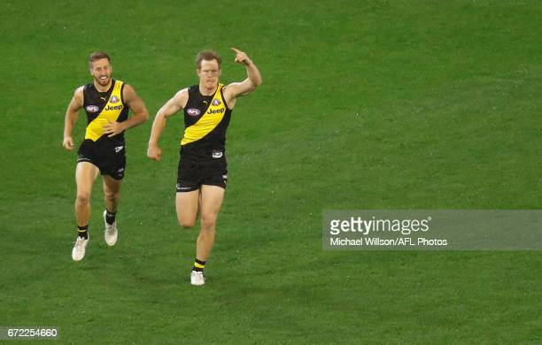 Kane Lambert and Jack Riewoldt of the Tigers celebrate during the 2017 AFL round 05 match between the Richmond Tigers and the Melbourne Demons at the...