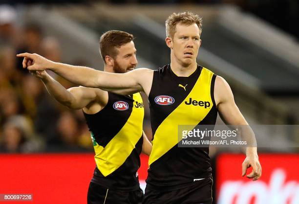 Kane Lambert and Jack Riewoldt of the Tigers celebrate during the 2017 AFL round 14 match between the Richmond Tigers and the Carlton Blues at the...