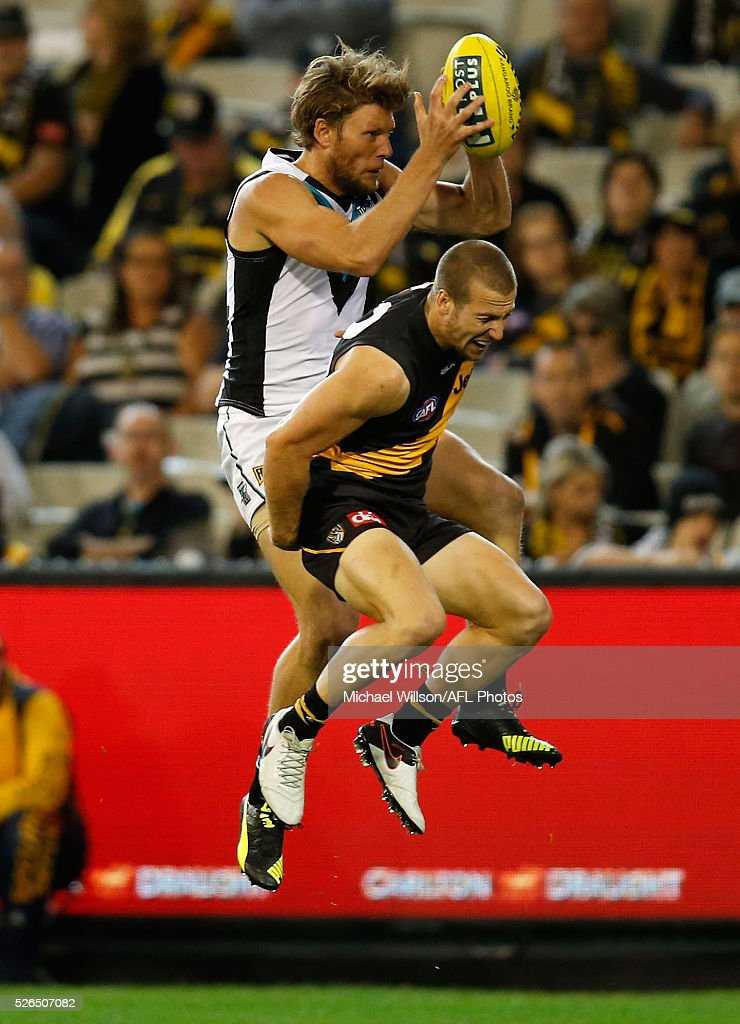 Kane Lambert of the Tigers injures himself in a marking contest against Brad Ebert of the Power during the 2016 AFL Round 06 match between the Richmond Tigers and Port Adelaide Power at the Melbourne Cricket Ground on April 30, 2016 in Melbourne, Australia.
