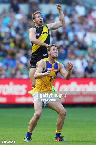 Kane Lambert of the Tigers leaps for the ball over Jack Redden of the Eagles during the round three AFL match between the Richmond Tigers and the...