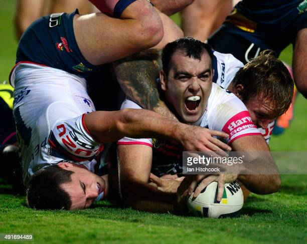 Kane Linnett of the Cowboys celebrates after scoring a try during the round 10 NRL match between the North Queensland Cowboys and the Sydney Roosters...