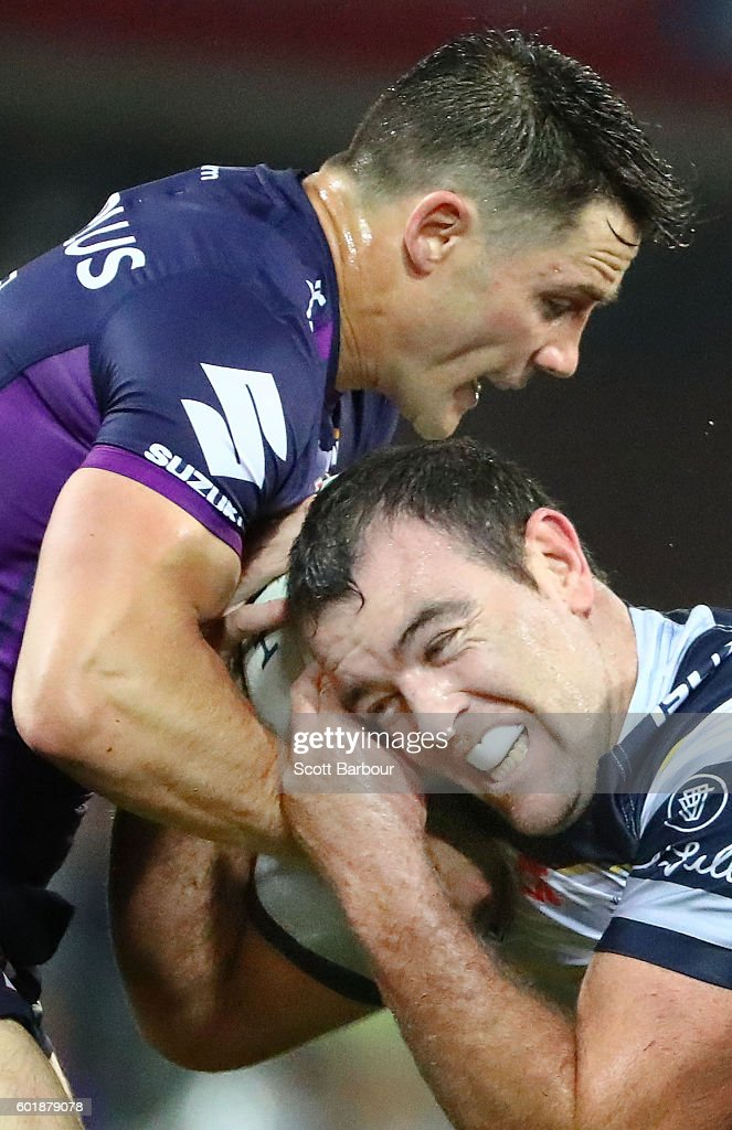 Kane Linnett of the Cowboys is tackled by Cooper Cronk of the Storm during the NRL Qualifying Final match between the Melbourne Storm and the North Queensland Cowboys at AAMI Park on September 10, 2016 in Melbourne, Australia.