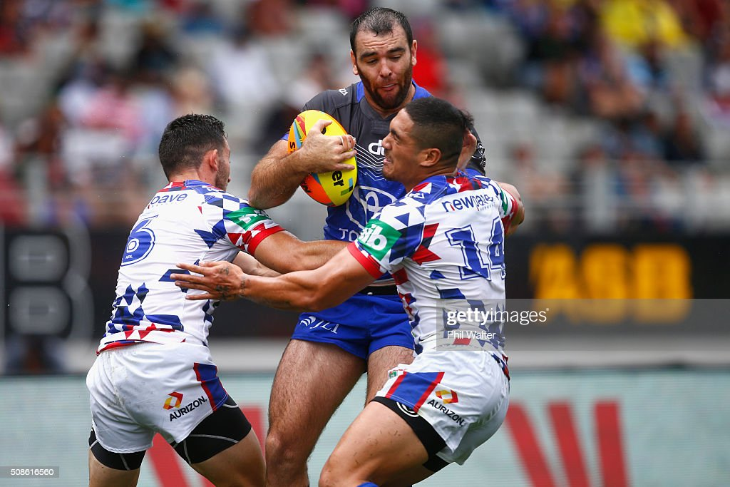 Kane Linnett of the Cowboys is tackled during the 2016 Auckland Nines match between the Cowboys and the Newcastle Knights at Eden Park on February 6, 2016 in Auckland, New Zealand.