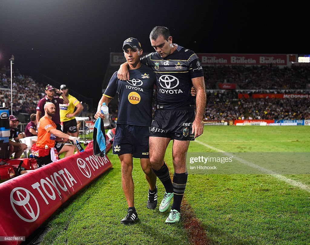 Kane Linnett of the Cowboys walks from the field after being injured during the round 16 NRL match between the North Queensland Cowboys and the Manly Sea Eagles at 1300SMILES Stadium on June 27, 2016 in Townsville, Australia.
