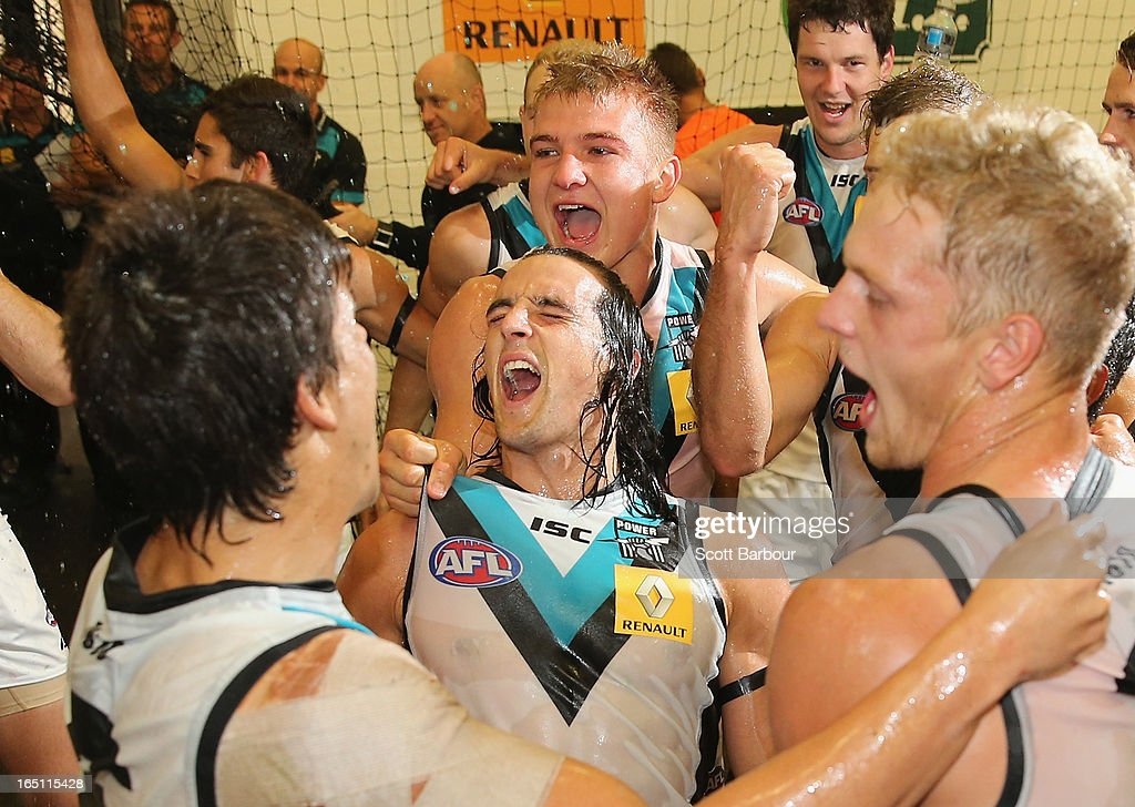 Kane Mitchell and Oliver Wines of the Power celebrate as they sing the team song in the dressing rooms after the round one AFL match between the Melbourne Demons and Port Adelaide Power at the Melbourne Cricket Ground on March 31, 2013 in Melbourne, Australia.