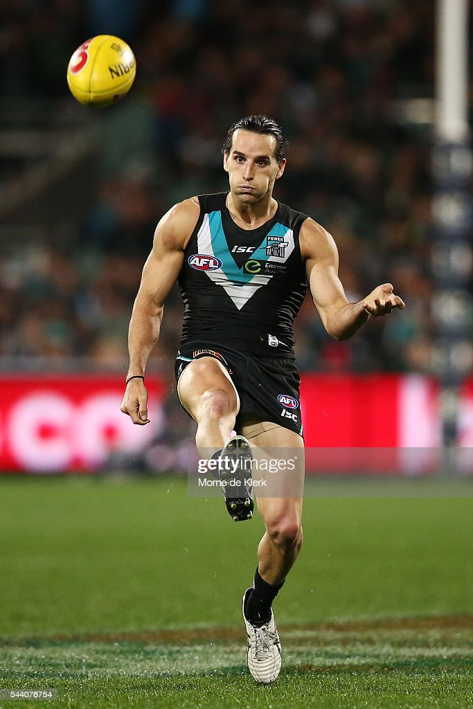 Kane Mitchell of the Power kicks the ball during the round 15 AFL match between the Port Adelaide Power and the Richmond Tigers at Adelaide Oval on July 1, 2016 in Adelaide, Australia.