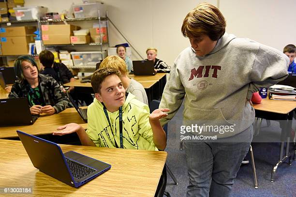 Kane Rawls shrugs his shoulders as he responds to a question by Jessica Noffsinger during an eighth grade science and engineering class at STEM Lab...