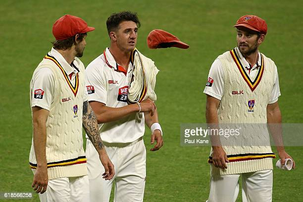 Kane Richardson Daniel Worrall and Chadd Sayers of the Redbacks walk from the field after dismissing the Warriors in the second innings during day...