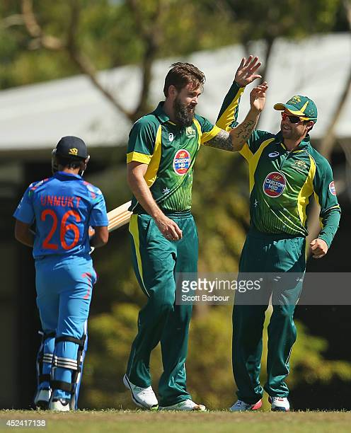 Kane Richardson of Australia A is congratulated after dismissing Unmukt Chand of India A during the Quadrangular One Day Series match between...