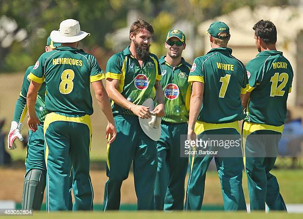Kane Richardson of Australia 'A' is congratulated after running out Manan Vohra of India 'A' during the Cricket Australia Quadrangular Series Final...