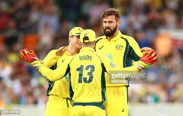 Kane Richardson of Australia celebrates with team mates after taking a wicket during the Victoria Bitter One Day International match between...