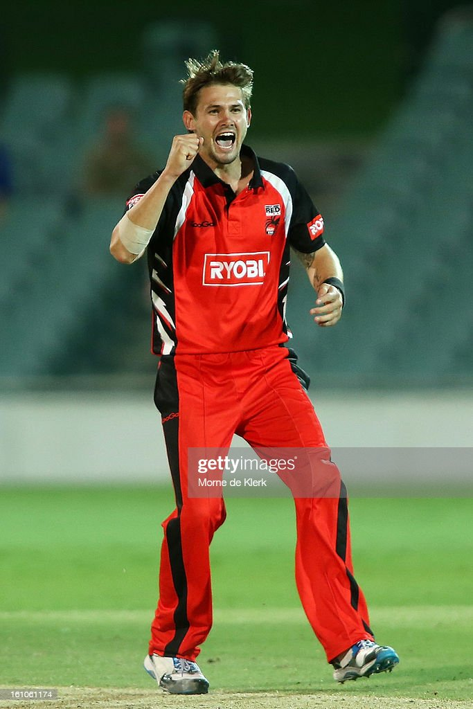 Kane Richardson (L) of the Redbacks celebrates after getting the wicket of David Hussey of the Bushrangers during the Ryobi One Cup Day match between the South Australian Redbacks and the Victorian Bushrangers at Adelaide Oval on February 9, 2013 in Adelaide, Australia.