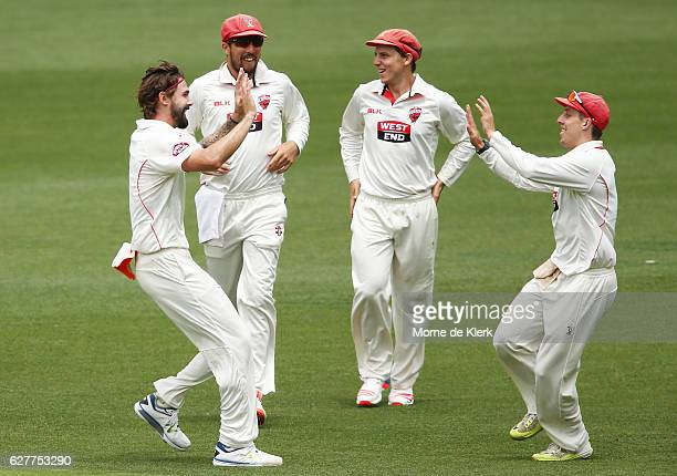 Kane Richardson of the Redbacks celebrates with teammates after getting the wicket of Kurtis Patterson of the NSW Blues during day one of the...