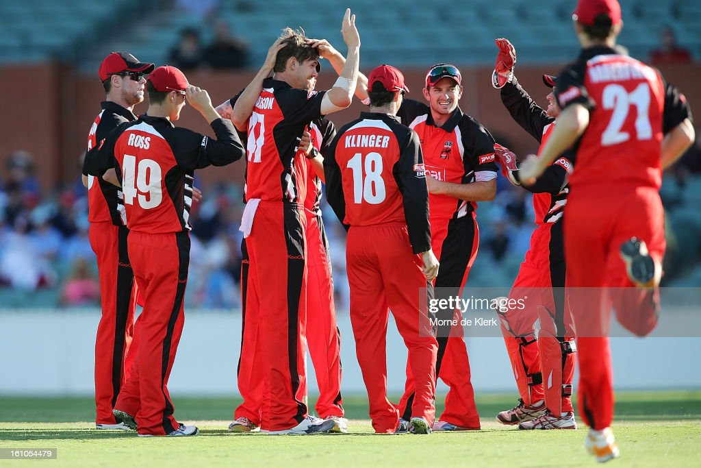 Kane Richardson of the Redbacks is congratulated by team mates after getting a wicket during the Ryobi One Cup Day match between the South Australian Redbacks and the Victorian Bushrangers at Adelaide Oval on February 9, 2013 in Adelaide, Australia.