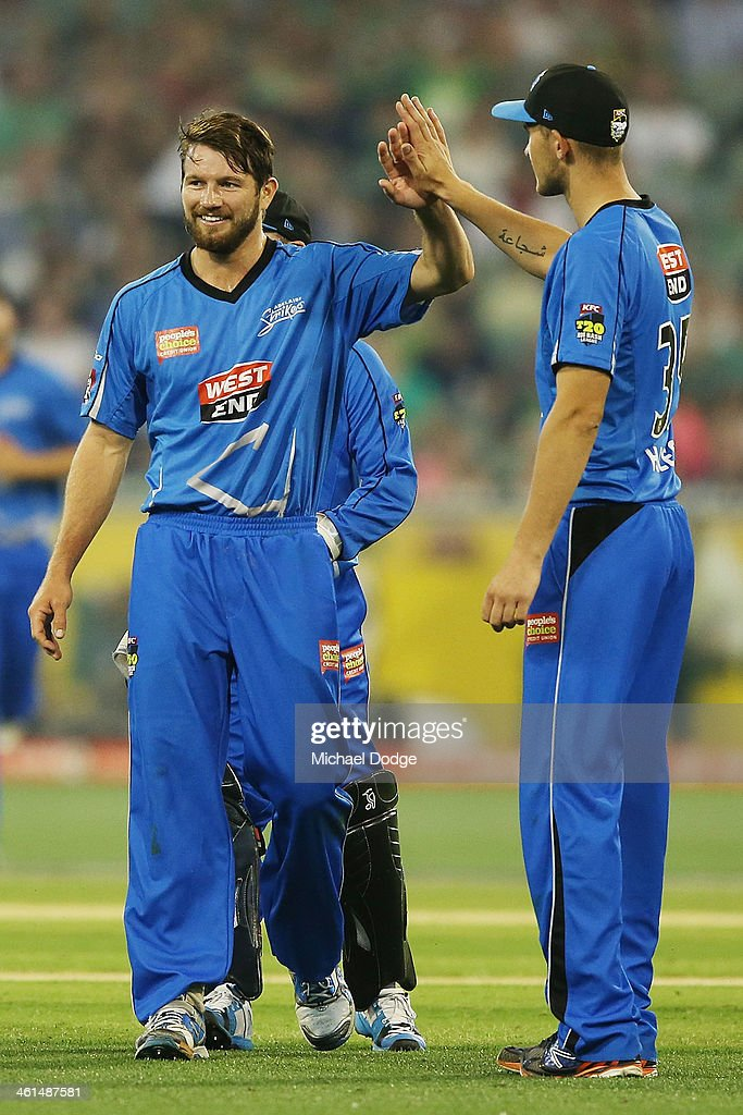Kane Richardson (L) of the Strikers celebrates his dismissal of Cameron White of the Stars during the Big Bash League match between the Melbourne Stars and the Adelaide Strikers at the Melbourne Cricket Ground on January 9, 2014 in Melbourne, Australia.