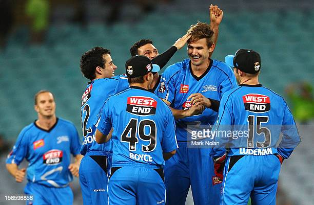Kane Richardson of the Strikers is congratulated after getting the wicket of Scott Coyte of the Thunder during the Big Bash League match between the...