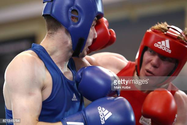 Kane Tucker of Northern Ireland is punched by Aaron Bowen of England as they compete in the Boy's 75 kg Gold Medal bout between Aaron Bowen of...