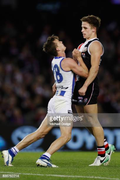Kane Turner of the Kangaroos wrestles with Jack Billings of the Saints during the round 22 AFL match between the St Kilda Saints and the North...