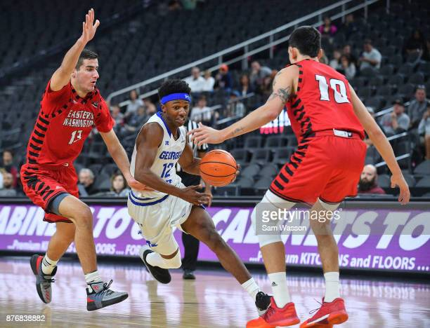 Kane Williams of the Georgia State Panthers drives against Luka Vulikic and Jacob Davison of the Eastern Washington Eagles during day one of the Main...