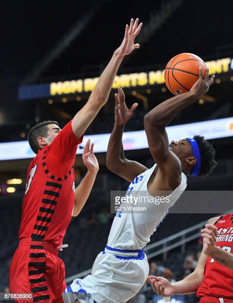Kane Williams of the Georgia State Panthers shoots against Luka Vulikic of the Eastern Washington Eagles during day one of the Main Event basketball...