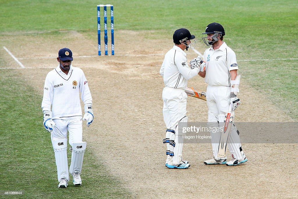 Kane Williamson and BJ Watling of New Zealand celebrate their 350 run partnership while Prasanna Jayawardene of Sri Lanka looks on during day four of...