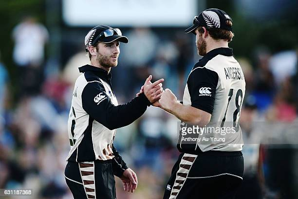Kane Williamson and Corey Anderson of New Zealand celebrate after winning the third Twenty20 International match between New Zealand and Bangladesh...