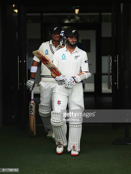 Kane Williamson and Corey Anderson of New Zealand walk out to bat during day four of the Test match between New Zealand and Australia at Hagley Oval...