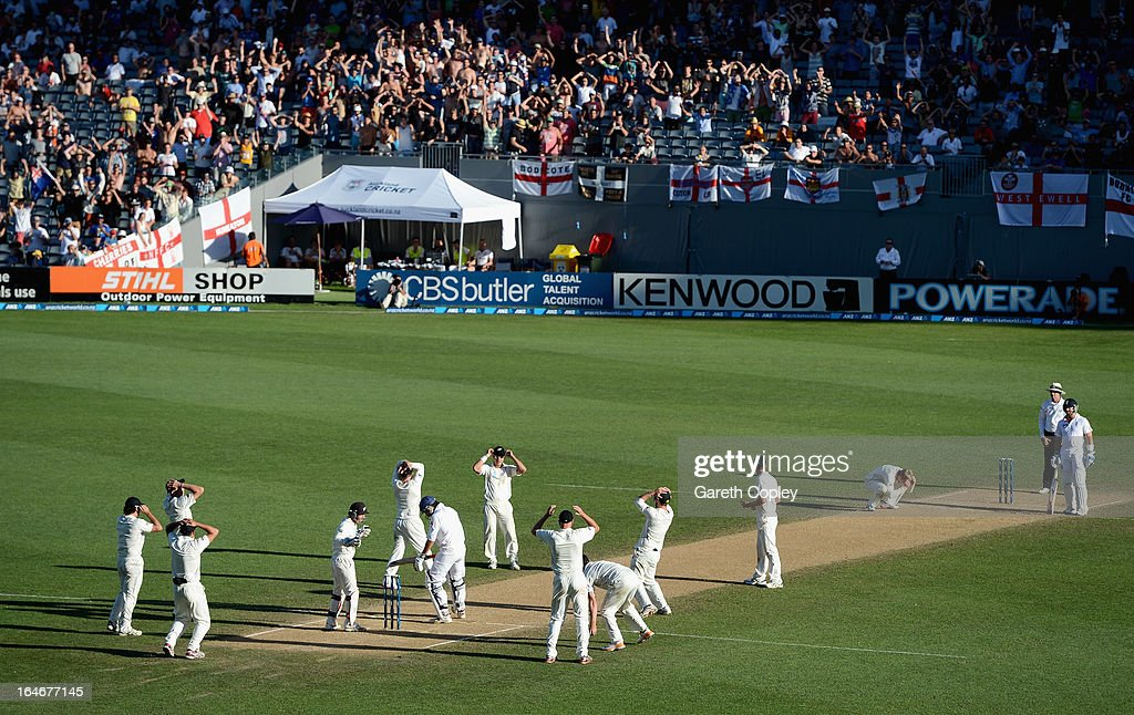 <a gi-track='captionPersonalityLinkClicked' href=/galleries/search?phrase=Kane+Williamson&family=editorial&specificpeople=4738503 ng-click='$event.stopPropagation()'>Kane Williamson</a> and his New Zealand fielders react after bowling to <a gi-track='captionPersonalityLinkClicked' href=/galleries/search?phrase=Monty+Panesar&family=editorial&specificpeople=592881 ng-click='$event.stopPropagation()'>Monty Panesar</a> of England during day five of the Third Test match between New Zealand and England at Eden Park on March 26, 2013 in Auckland, New Zealand.