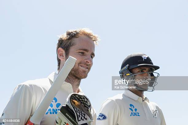 Kane Williamson and Jeet Raval of New Zealand walk from the ground at the lunch break during day four of the First Test between New Zealand and...