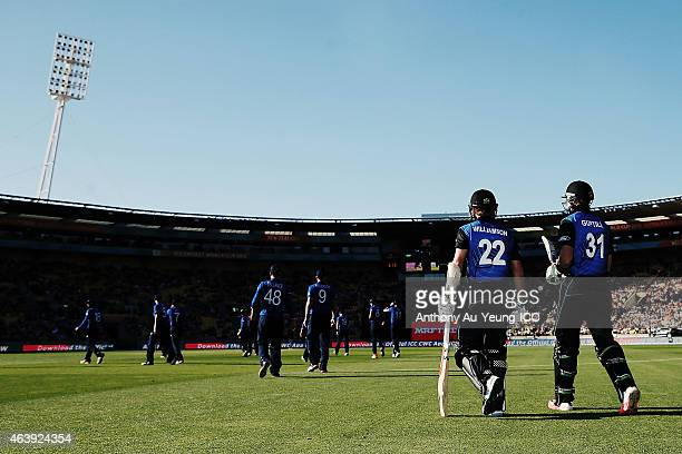 Kane Williamson and Martin Guptill of New Zealand walk out to the field during the 2015 ICC Cricket World Cup match between England and New Zealand...