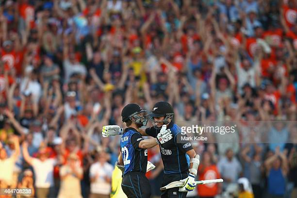 Kane Williamson and Trent Boult of New Zealand celebrate victory during the 2015 ICC Cricket World Cup match between Australia and New Zealand at...