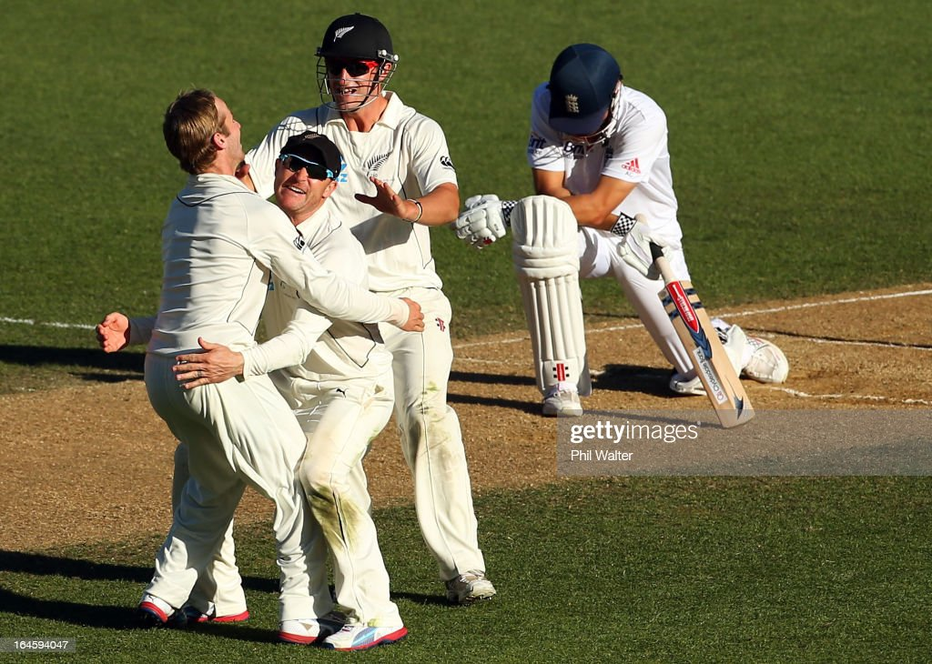 Kane Williamson Brendon McCullum and Hamish Rutherford of New Zealand celebrate the wicket of Alastair Cook of England during day four of the Third...