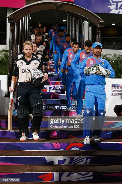 Kane Williamson Captain of New Zealand and MS Dhoni Captain of India lead their teams out onto the pitch during the ICC World Twenty20 India 2016...