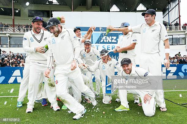 Kane Williamson escapes a dousing of champagne as New Zealand celebrate their ANZ Test Series win during day five of the Second Test match between...