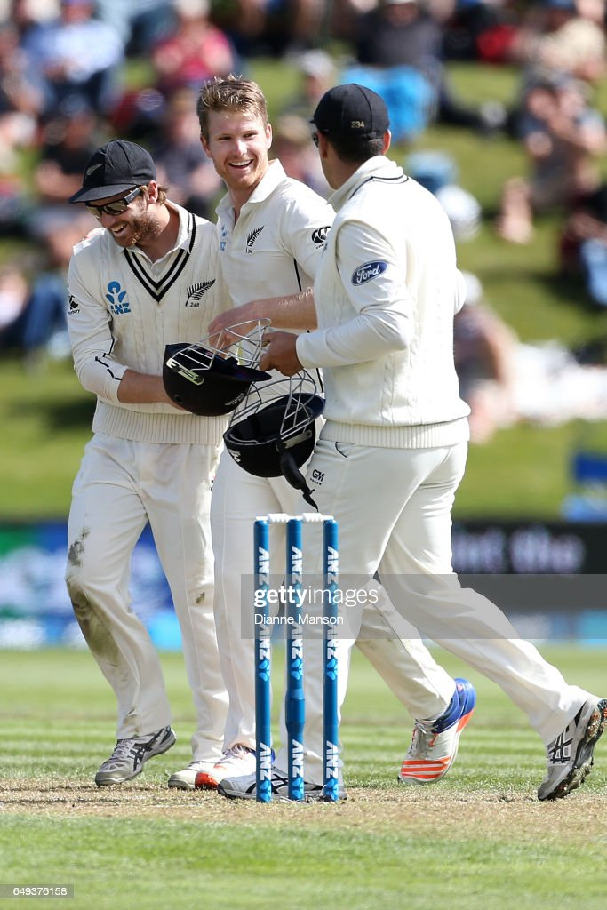 Kane Williamson (L), Jimmy Neesham and Ross Taylor of New Zealand celebrate the dismissal of Faf du Plessis of South Africa during day one of the First Test match between New Zealand and South Africa at University Oval on March 8, 2017 in Dunedin, New Zealand.