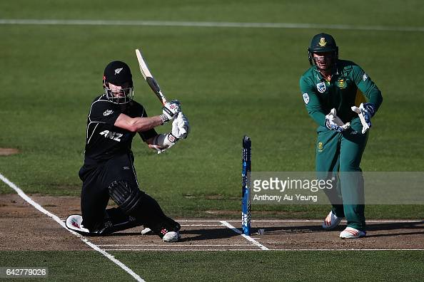 Kane Williamson of New Zealand bats as Quinton de Kock of South Africa looks on during the First One Day International match between New Zealand and...